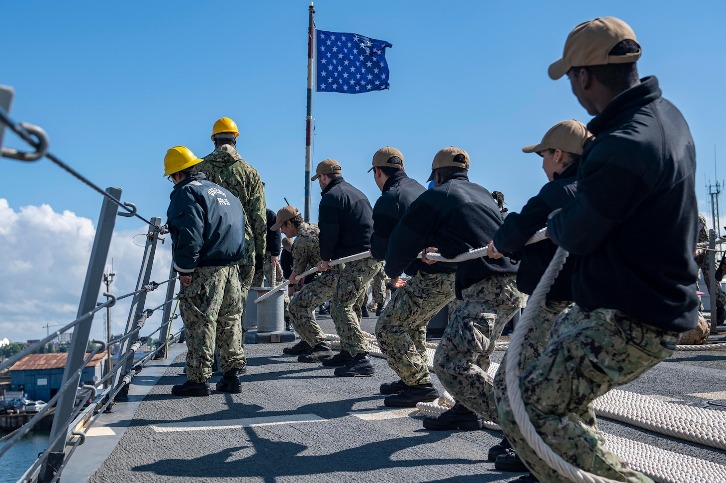 CONSTANTA, Romania (June 18, 2021) Sailors assigned to the Arleigh Burke-class guided-missile destroyer USS Laboon (DDG 58) heave a mooring line as Laboon arrives in Constanta, Romania, June 18, 2021. Laboon is deployed to the U.S. Sixth Fleet area of operations in support of U.S. national security interests in Europe and Africa. (U.S. Navy photo by Mass Communication Specialist Seaman Jeremy R. Boan/Released)