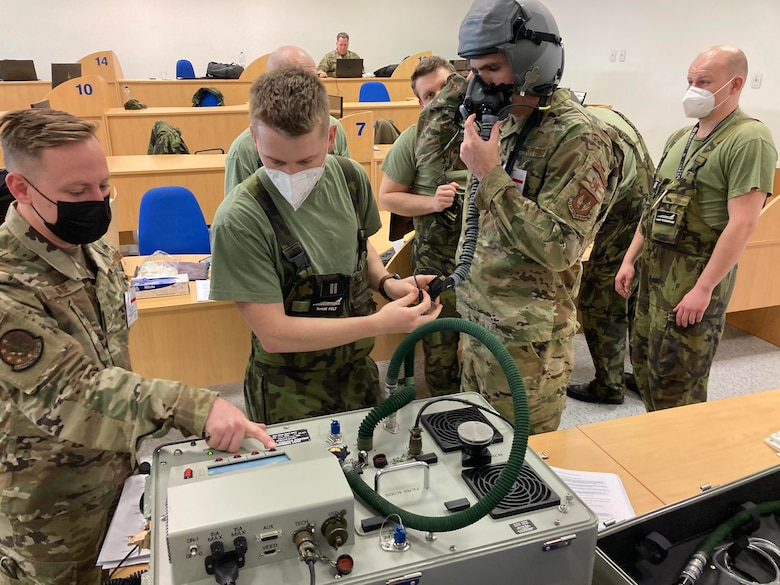 An Airman teaches the Czechian AF about joint aircrew system testers.
