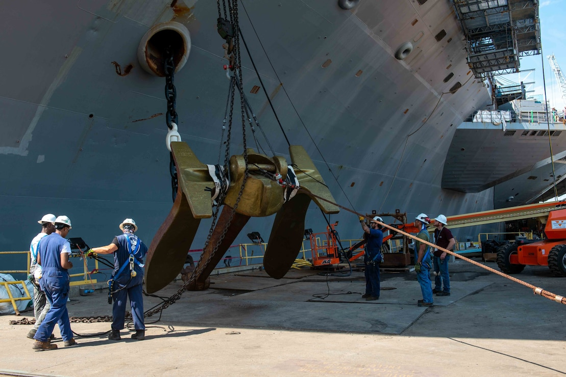 Newport News Shipbuilding contractors remove the port side anchor from the aircraft carrier USS John C. Stennis (CVN 74).
