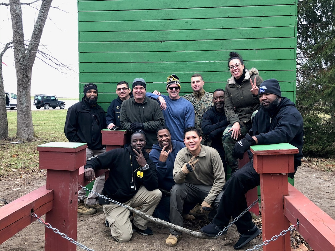 Group of men and women pose during leadership training for DLA's rapid deployment team duty.