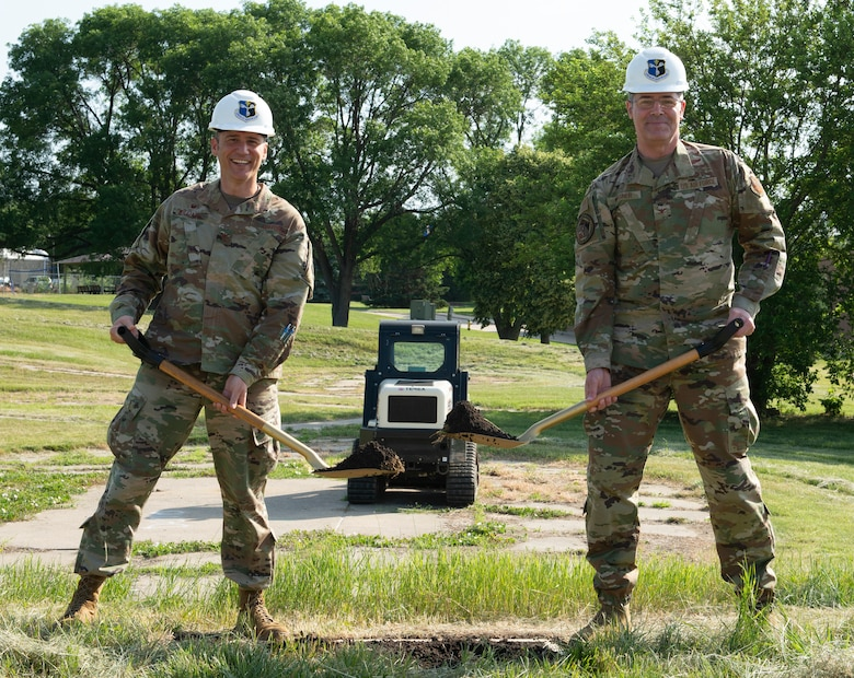 (L to R) Col. Patrick Williams, 557th Weather Wing commander, and Col. Richard Wagner, Deputy Director of Air Force Weather, who served as the 557th WW vice commander from 2016 - 2019, break ground on June 16, 2021 for a $4.1 million backup generator project at Offutt Air Force Base, Nebraska.