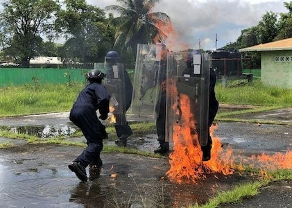 A Guyanese Police Force cadet as they undergoes petrol bomb training.