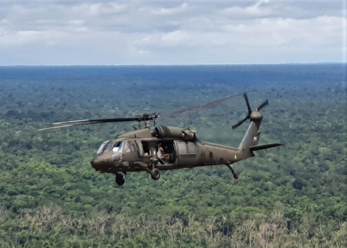 A UH-60 Blackhawk flies over the jungles of Guyana.
