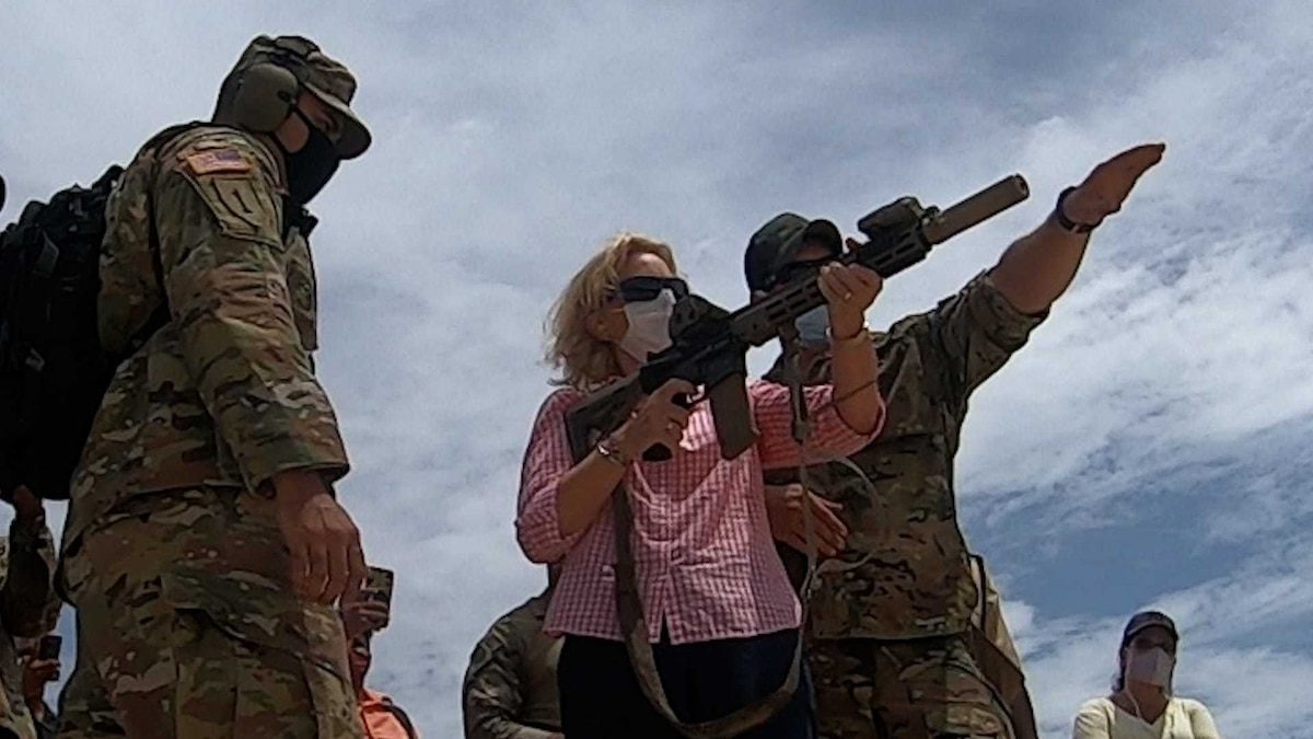 A U.S. Soldier with 7th Special Forces Group instructs U.S. Ambassador to the Co-operative Republic of Guyana, Sarah-Ann Lynch, on marksmanship skills during Tradewinds 2021.
