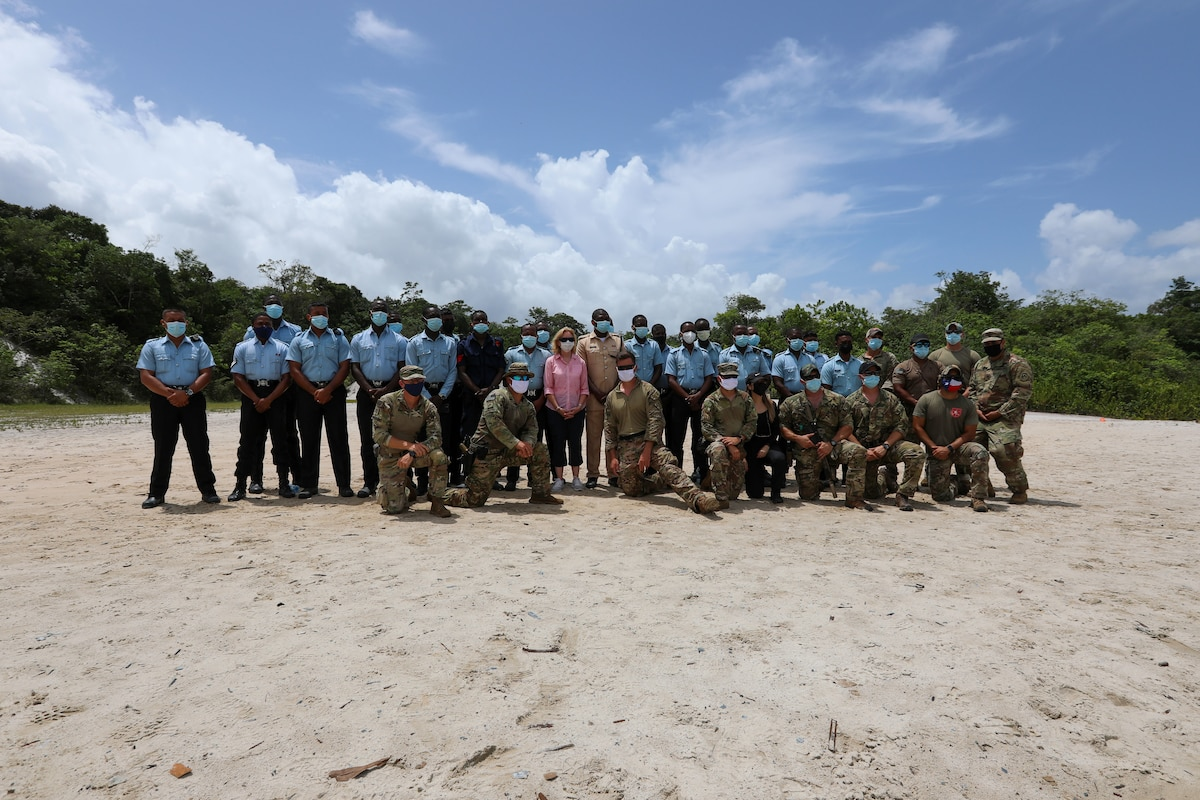 U.S. Ambassador to the Co-operative Republic of Guyana, Sarah-Ann Lynch poses for a group photo with U.S. and Guyana personnel during Tradewinds 2021.