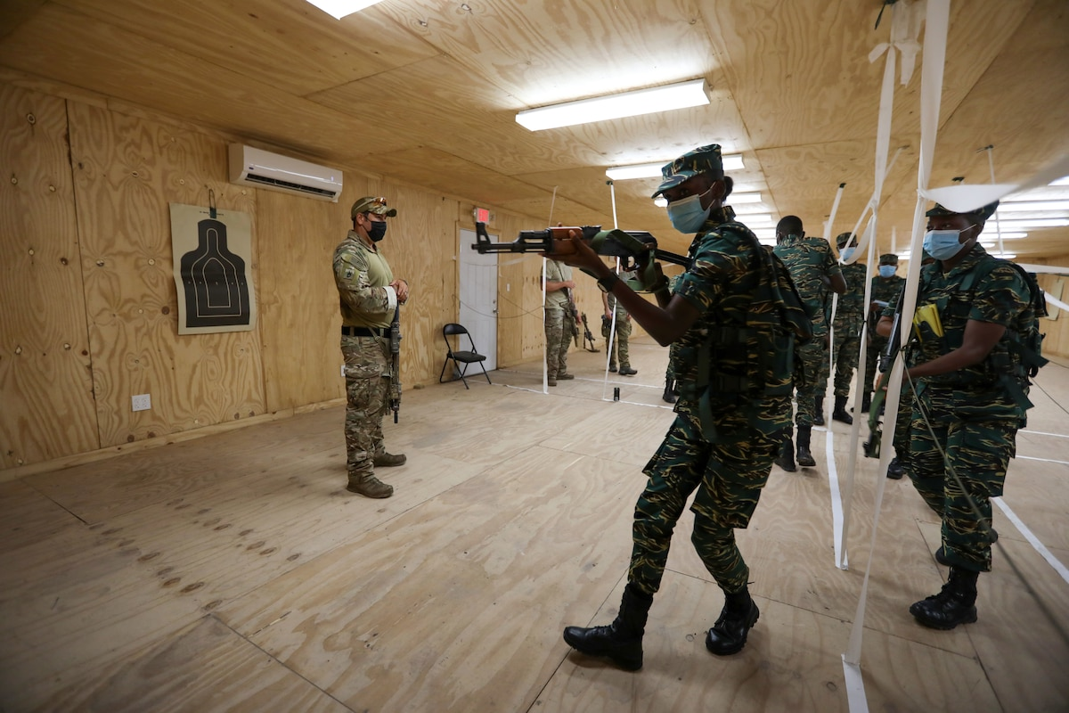 U.S. Soldiers from the Florida Army National Guard's (FLARNG) 2-54 Security Force Assistance Brigade (SFAB) and Drug Enforcement Administration (DEA) agents instruct Guyana Defence Force (GDF) Soldiers on room clearing tactics.