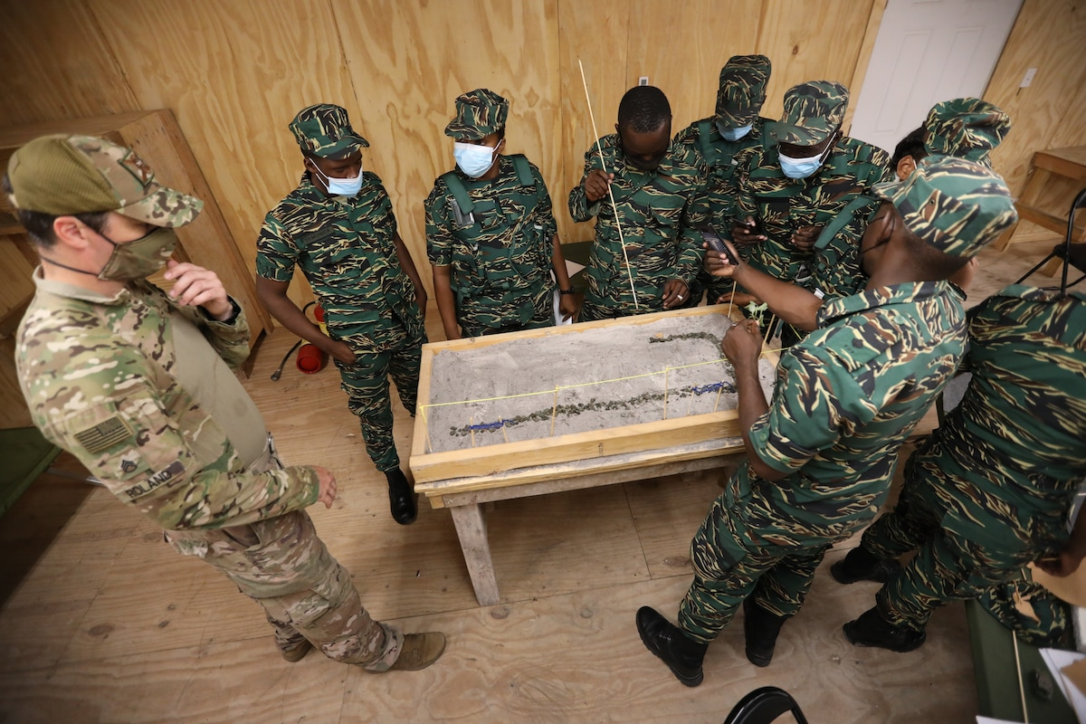 A Soldier from the Florida Army National Guard's Security Force Assistance Brigade (SFAB) advises members of the Guyana Defence Force.