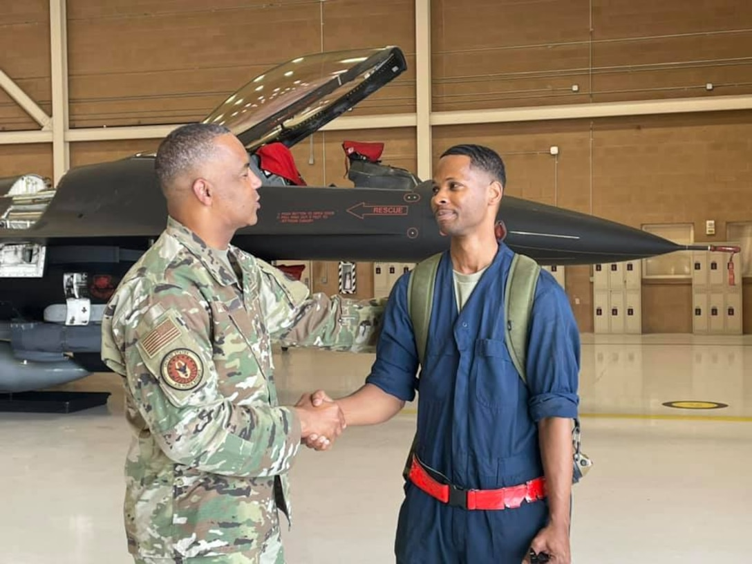 Chief Master Sgt. Timothy White, Senior Enlisted Advisor to the Chief of Air Force Reserve and Command Chief Master Sergeant of Air Force Reserve Command, greets Staff Sgt. Aaron Raiford, 926th Aircraft Maintenance Squadron, during a visit to the 926th Wing, June 16, at Nellis Air Force Base, Nevada. White is visiting as part of the Reserve Senior Enlisted Council hosted by 10th Air Force. (U.S. Air Force photo by Natalie Stanley)
