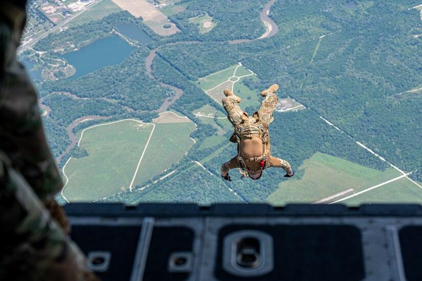 A guardsman jumps out of an aircraft.