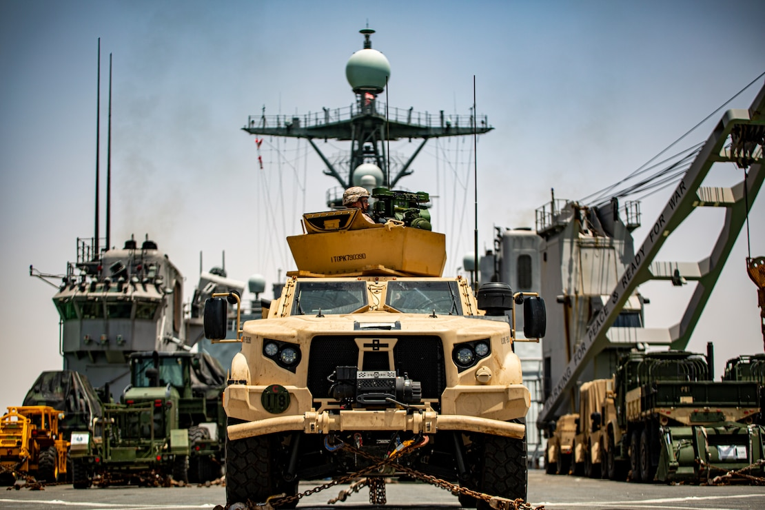 A Marine in a joint light tactical vehicle, assigned to the 24th Marine Expeditionary Unit, provides rear security aboard dock landing ship USS Carter Hall (LSD 50) while transiting the Suez Canal, June 1. The Iwo Jima Amphibious Ready Group and the 24th Marine Expeditionary Unit are deployed to the U.S. 5th Fleet area of operations in support of naval operations to ensure maritime stability and security in the Central Region, connecting the Mediterranean and Pacific through the western Indian Ocean and three strategic choke points.