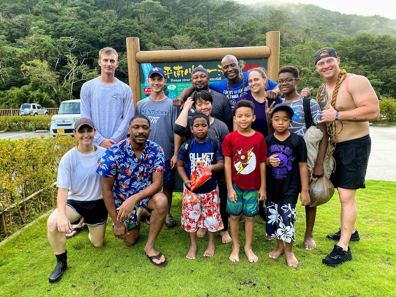 U.S. Marines, Sailors, civilians and their families pose for a photo after surviving a flash flood at Ta-Taki Falls, Okinawa, Japan, Sept. 13, 2020. The members of the group found themselves in a life-threatening situation and assisted each other and local nationals to return safely.