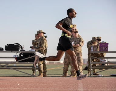 Sgt. Ellahimod Alexander, a human resources noncommissioned officer assigned to Area Support Group - Kuwait, crosses the finish after completing the two-mile run during the Army Combat Fitness Test for the U.S. Army Central 2021 Best Warrior Competition at Camp Buehring, Kuwait, June 21, 2021. Competitors from across the ARCENT area or responsibility are competing in various events to be crowned the title of best warrior. (U.S. Army photo by Staff Sgt. True Thao, U.S. Army Central Public Affairs)