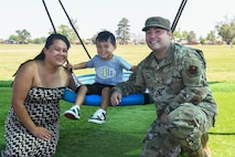 airman poses with family