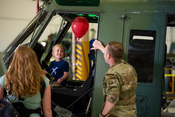 Wyatt, 3, mans the pilot seat of a UH-1N Huey at F. E. Warren Air Force Base, Wyoming, Friday, June 18, 2021. Dependents and family members were invited to visit various units and missions across the base for the 90th Missile Wing Family Weekend activities. (U.S. Air Force photo by Jordan Pickett)