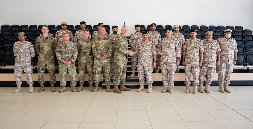 Members of the West Virginia National Guard and the Qatar Emiri Land Forces at QELF headquarters in Doha, Qatar, June 21, 2021. West Virginia and Qatar formalized their partnership during the visit with Qatari Armed Forces as a part of the National Guard Bureau's State Partnership Program.