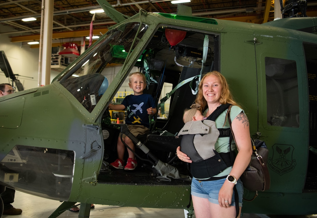 Wyatt, 3, and his mother Kaylee explore a UH-1N Huey at F. E. Warren Air Force Base, Wyoming, June 18, 2021. Dependents and family members were invited to visit various units across the base for the 90th Missile Wing Family Weekend activities. (U.S. Air Force photo by Jordan Pickett)