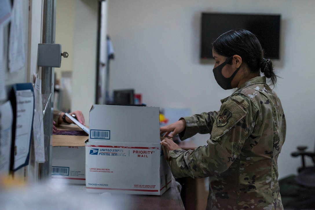 U.S. Air Force Airmen from the 380th Expeditionary Force Support Squadron, sort mail packages at Al Dhafra Air Base (ADAB), United Arab Emirates, June 16, 2021. The ADAB post office averages 52,000 lbs across 8,500 packages a month.