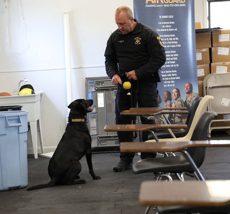 K9 Maizey works with her handler Dan Diblasio, a police officer with the Schenectady County Sheriff Office. The Officers and K9s recently trained at Stratton ANGB where they also provide support to the Security Forces Squadron when needed. (U.S. Air National Guard photo by Ms. Jaclyn Lyons)