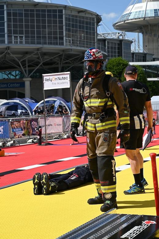 Master Sgt. Sean Sullivan, assistant chief of training in the 445th Civil Engineer Squadron, puts on his gear before competing in the FireFit Europe Championships June 20, 2021 in Hannover, Germany. Amid 400 contenders, Sullivan ranked first in the over-40 age category, and eighth overall. He travelled from Frankfort, Kentucky, to compete in the multiday event. (U.S. Air Force photo/Capt. Rachel Ingram)