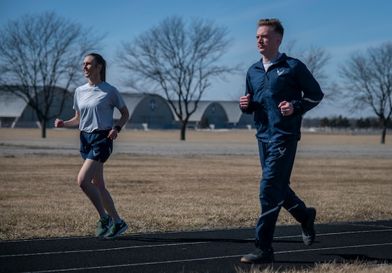 Image of two Airmen running.
