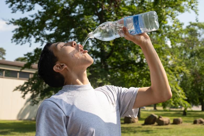 Young man waterfalls water bottle.