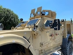 An MRAP with bullet marks.