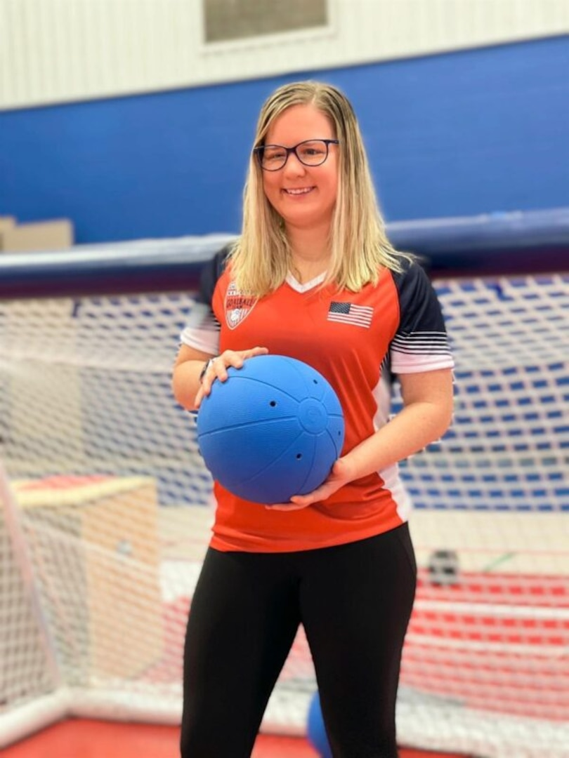 Mindy Cook holds a custom ball designed for the paralympic sport of goalball.