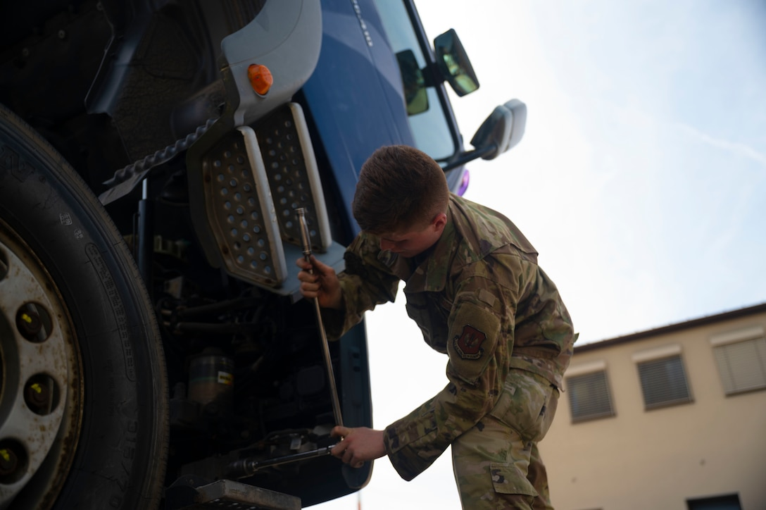 U.S. Air Force Airman 1st Class Dylan Mahon, 86th Vehicle Readiness Squadron vehicle maintenance apprentice, inspects a tractor-trailer