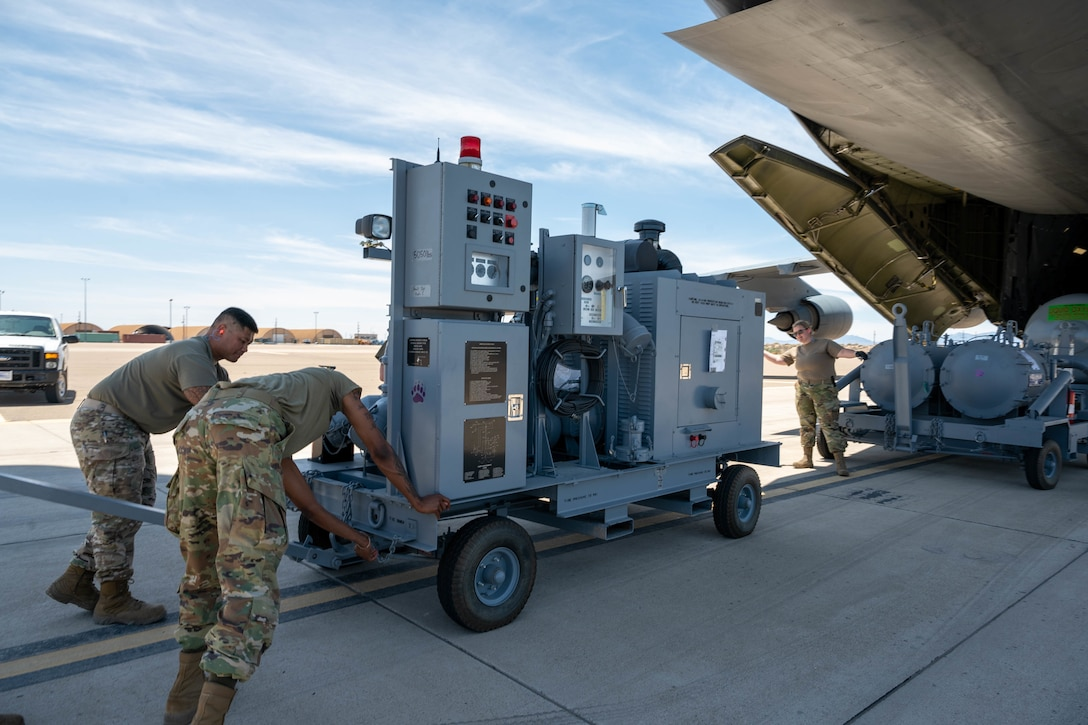 Airmen from the 49th Logistics Readiness Squadron load aircraft ground equipment onto a Dover Air Force Base C-5M Super Galaxy during a Major Command Service Tail Trainer, at Holloman AFB, New Mexico, June 8, 2021. Loadmasters from the 9th Airlift Squadron coordinated cargo with Airmen from Air Education and Training Command's 49th Wing and Air Force Materiel Command's 635th Materiel Maintenance Group to complete the 10-day MSTT. Over the course of the training, Airmen loaded and unloaded 320,085 pounds of cargo, including palletized cargo, AGE, a fuel truck and a K-loader. (U.S. Air Force photo by Senior Airman Faith Schaefer)