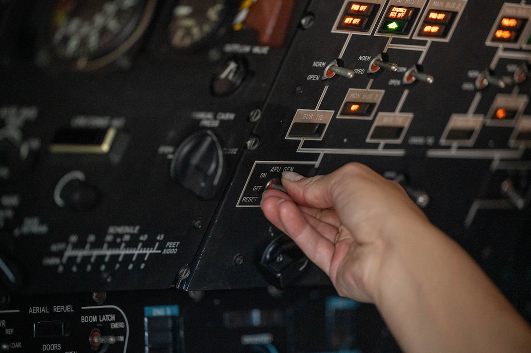 Airman 1st Class Rebecca Reimer, 9th Airlift Squadron loadmaster student, turns on the auxiliary power units of a Dover Air Force Base C-5M Super Galaxy during a Major Command Service Tail Trainer at Holloman AFB, New Mexico, June 8, 2021. The 9th AS performs MSTTs to expedite upgrade and qualification training for C-5M loadmasters and flight engineers. Of the 350 tasks needed to be a fully qualified loadmaster, roughly half can be completed during an MSTT, reducing training time by up to 35 days. (U.S. Air Force photo by Senior Airman Faith Schaefer)