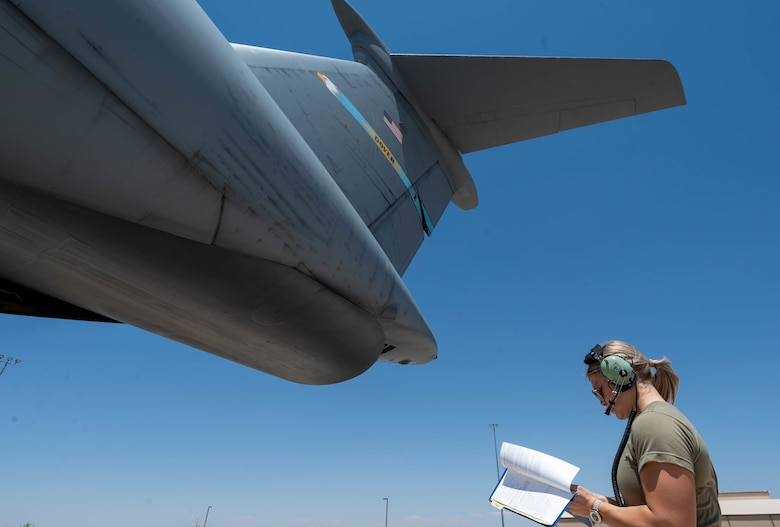 Airman 1st Class Rebecca Reimer, 9th Airlift Squadron loadmaster student, checks a pre-loading checklist for a Dover Air Force Base C-5M Super Galaxy during a Major Command Service Tail Trainer at Holloman AFB, New Mexico, June 7, 2021. The 9th AS performs MSTTs to expedite upgrade and qualification training for C-5M loadmasters and flight engineers. Of the 350 tasks needed to be a fully qualified loadmaster, roughly half can be completed during an MSTT. (U.S. Air Force photo by Senior Airman Faith Schaefer)