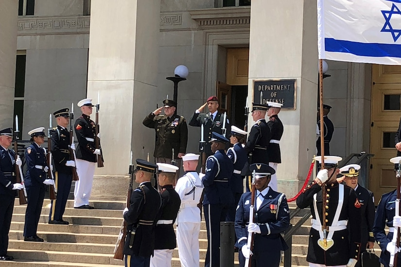 Two generals salute at the steps of the Pentagon.