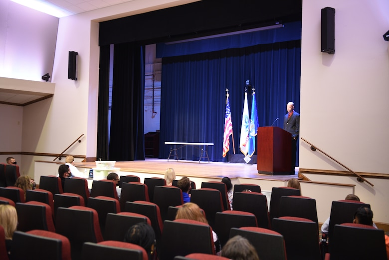 Thomas DuBois, Fort Eustis Project SEARCH coordinator, speaks to graduates and their families in the Wylie Theater at Joint Base Langley-Eustis, Virginia.