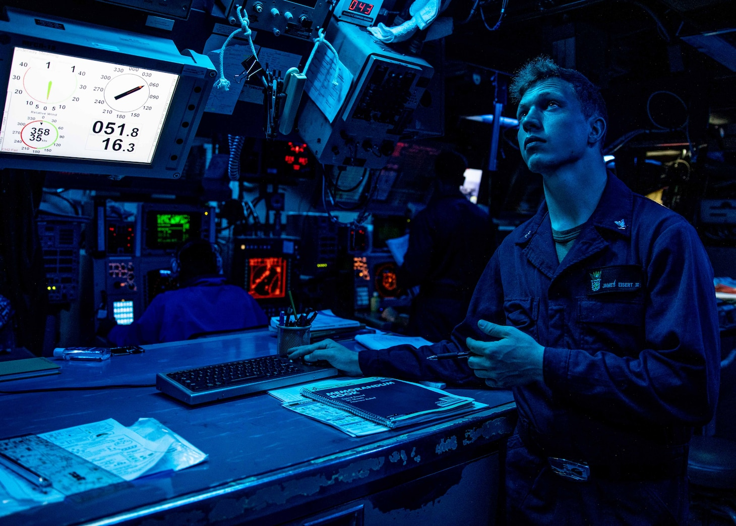 TAIWAN STRAIT (June 22, 2021) – Fire Controlman (Aegis) 3rd Class James Eisert, from Philadelphia, stands watch in combat systems while Arleigh Burke-class guided-missile destroyer USS Curtis Wilbur (DDG 54) as the ship conducts routine operations. Curtis Wilbur is assigned to Commander, Task Force 71/Destroyer Squadron (DESRON) 15, the Navy's largest forward-deployed DESRON and U.S. 7th Fleet's principal surface force.