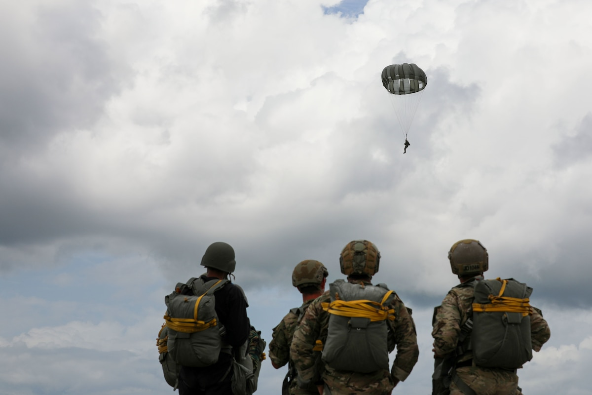 Soldiers conduct parachute jump training in Guyana.