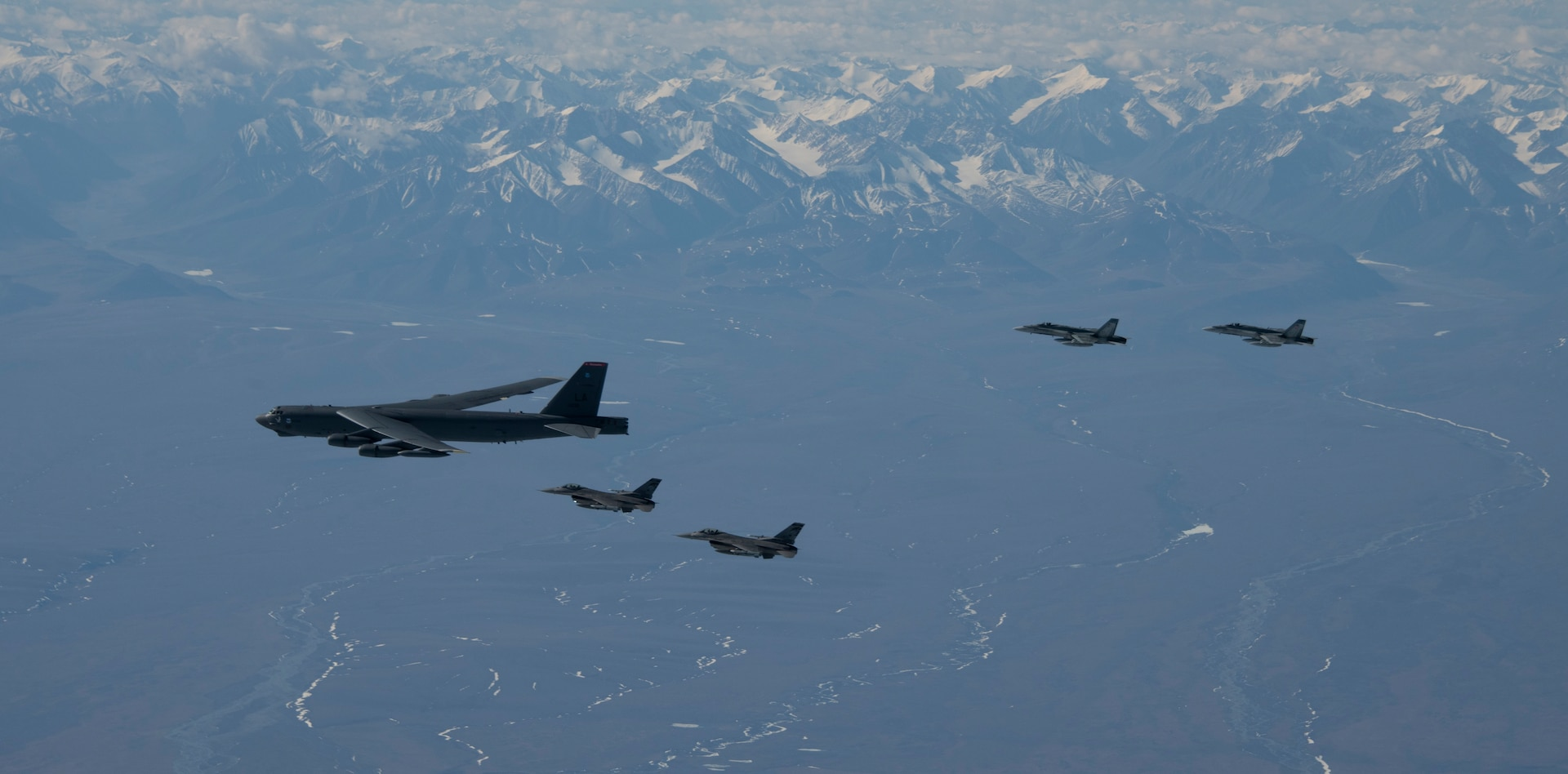 Royal Canadian Air Force CF-18 Hornet and United States Air Force F-16 Fighting Falcon fighter jets fly in formation with a United States Air Force B-52 Stratofortress over Alaska, during Exercise Amalgam Dart 21-1, June 15, 2021.