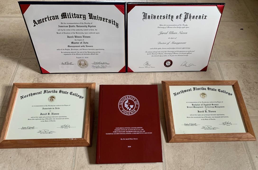 MSgt Jared Nieves Displays Diplomas.