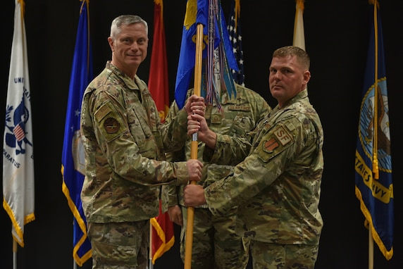 U.S. Air Force Col. Tony England, 17th Mission Support Group commander, takes the guidon from Lt. Col. Richard Buckley, outgoing 17th Security Forces Squadron commander, during the change of command ceremony at the Event Center on Goodfellow Air Force Base, Texas, June 22, 2021. Buckley is taking a position at the Air Force Security Forces Center at Lackland AFB. (U.S. Air Force photo by Senior Airman Ashley Thrash)