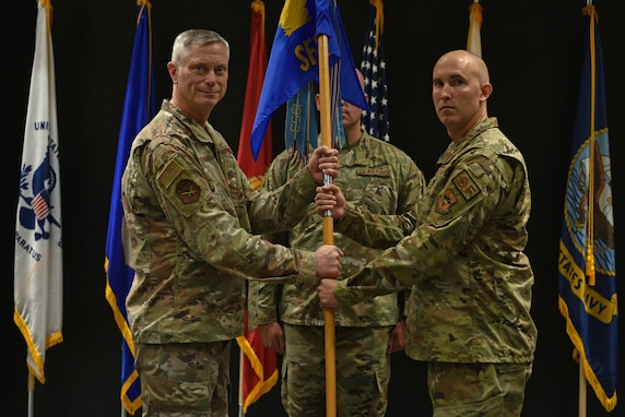 U.S. Air Force Col. Tony England, 17th Mission Support Group commander, passes the guidon to Capt. Heath Turley, incoming 17th Security Forces Squadron commander, during the change of command ceremony at the Event Center on Goodfellow Air Force Base, Texas, June 22, 2021. Turley was previously the antiterrorism action officer for the U.S. European Command in Germany. (U.S. Air Force photo by Senior Airman Ashley Thrash)