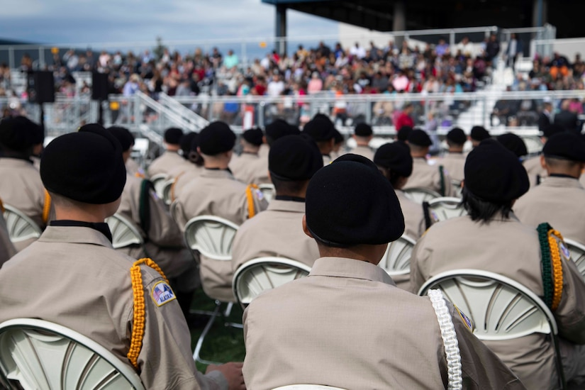 Alaska Military Youth Academy cadets stay seated during the keynote speech at AMYA's graduation ceremony, held at the Bartlett High School Football Field in Anchorage, June 18, 2021. The ceremony featured Alaska Lt. Gov. Kevin Meyer as the keynote speaker for the 79 graduating cadets and their families. (U.S Army National Guard photo by Victoria Granado)