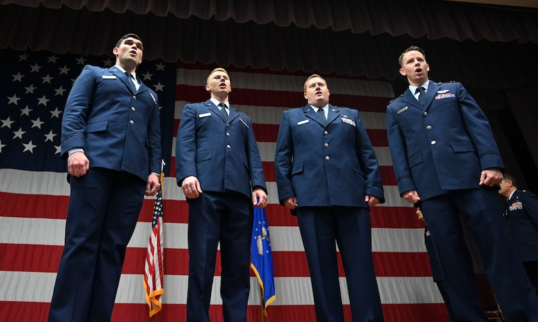 A choir comprised of two instructor pilots and two student pilots assigned to the 14th Flying Training Wing, preform the National Anthem during a change of command ceremony, June 21, 2021, on Columbus Air Force Base, Miss. The mission of the 14th Student Squadron is to ensure student pilots have everything they need to become both officers and pilots while providing unrivaled academic and simulator training. (U.S. Air Force photo by Airman 1st Class Jessica Haynie)