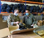 U.S. Army Lt. Col. Brian Bosse, ground programs chief with the Joint U.S. Military Assistance Group – Philippines, shows Philippine Air Force Lt. Col. Mark Anthony Madumma, contract management for international logistics officer with OJ4, GHQ, AFP, a newly delivered tactical helmet at Clark Air Base.