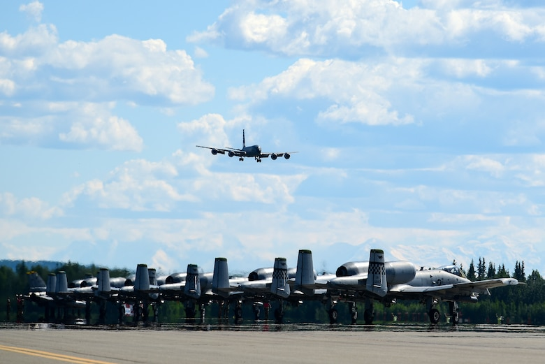 F-16 Fighting Falcons assigned to the 8th Fighter Wing, Kunsan Air Base, Republic of Korea, and A-10 Thunderbolt II's assigned to the 25th Fighter Squadron, Osan Air Base, Republic of Korea, wait for takeoff during Red Flag-Alaska 21-2 at Eielson Air Force Base, Alaska, June 16, 2021. This exercise provides unique opportunities to integrate various forces into joint and multilateral training from simulated forward operating bases. (U.S. Air Force photo by Senior Airman Suzie Plotnikov)