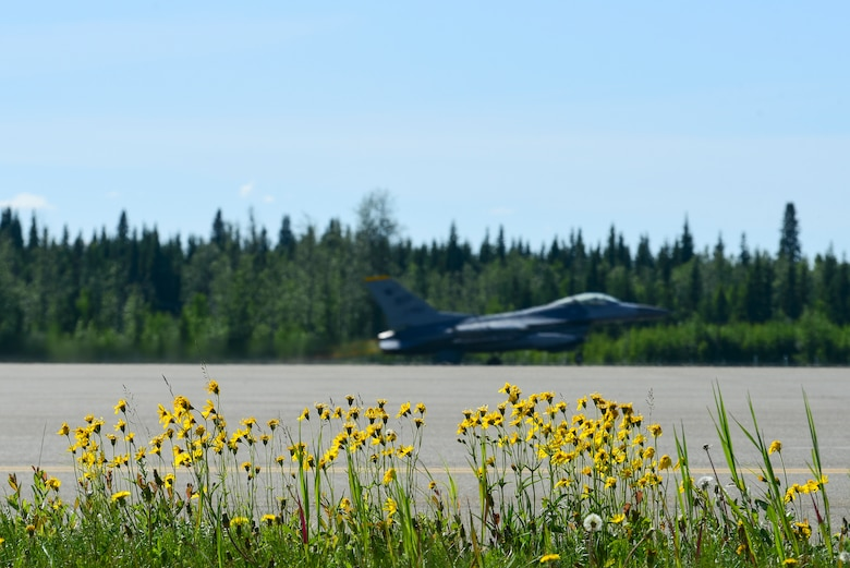 An F-16 Fighting Falcon takes off during Red Flag-Alaska 21-2 at Eielson Air Force Base, Alaska, June 16, 2021. RF-A is a Pacific Air Forces-directed field training exercise designed to provide U.S. and allied forces realistic air combat training for which enhances joint and bilateral interoperability in the Indo-Pacific region. (U.S. Air Force photo by Senior Airman Suzie Plotnikov)
