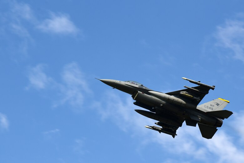 An F-16 Fighting Falcon flies over Eielson Air Force Base, Alaska, during Red Flag-Alaska 21-2 at Eielson AFB, Alaska, June 17, 2021. RF-A reinforces the United States' continued commitment to the region as a Paciic nation, leader and power. (U.S. Air Force photo by Senior Airman Suzie Plotnikov)