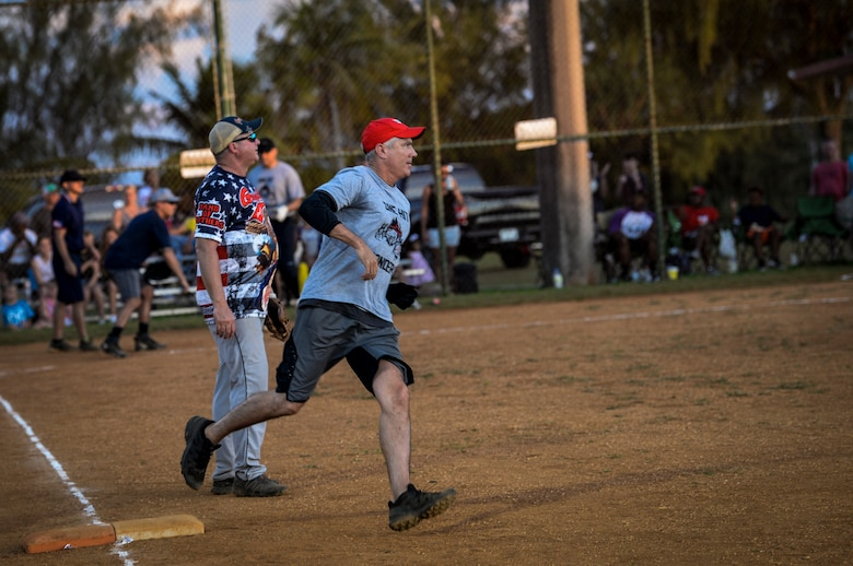 U.S. Air Force Brig. Gen. Jeremy Sloane, 36th Wing commander, runs passed first base during the Chief's versus Eagle's softball game at Andersen Air Force Base, Guam, June 18, 2021.