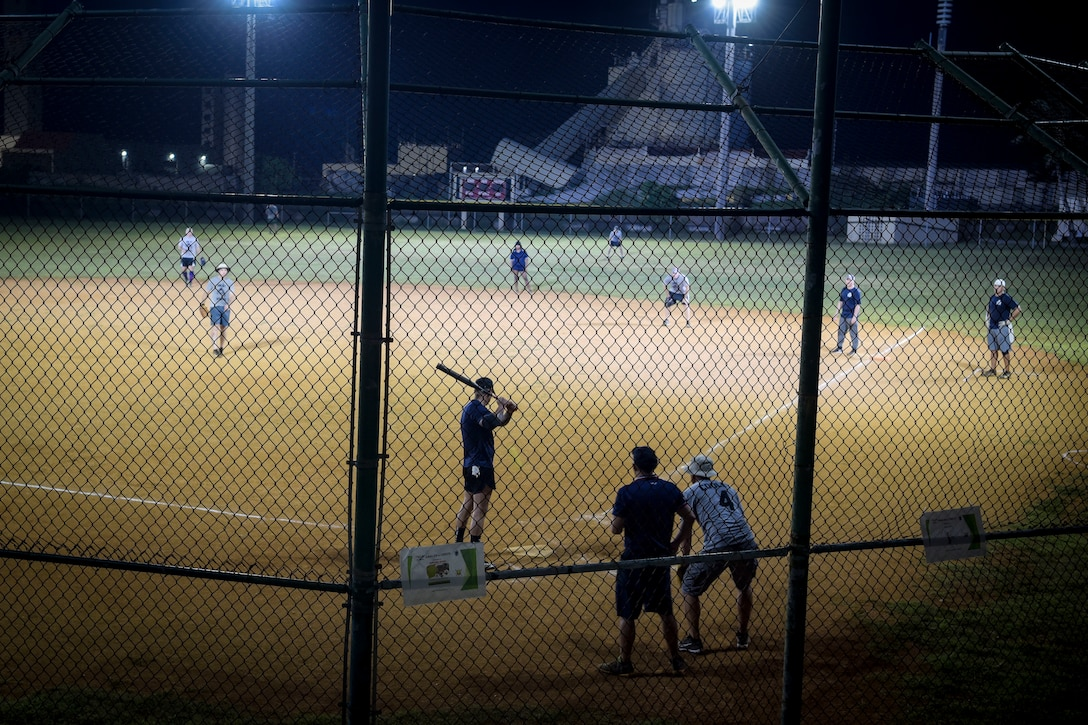 Team Andersen leadership participates in a Chief's versus Eagle's softball game at Andersen Air Force Base, Guam, June 18, 2021.
