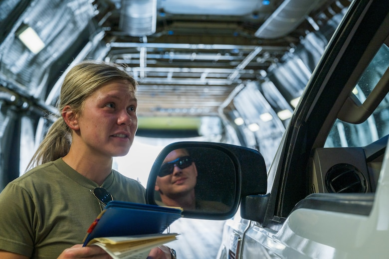 Airman 1st Class Rebecca Reimer, 9th Airlift Squadron loadmaster student, discusses offloading procedures with Staff Sgt. Jordan Chandanais, 49th Logistics Readiness Squadron Air Transportation Function supervisor, while aboard a Dover Air Force Base C-5M Super Galaxy during a Major Command Service Tail Trainer at Holloman AFB, New Mexico, June 7, 2021. Following an initiative from Air Mobility Command, MSTTs have been in the training plan of the 9th AS since early 2021 to expedite upgrade and qualification training for C-5M Super Galaxy loadmasters and flight engineers. This MSTT was coordinated in partnership with Air Education Training Command's 49th Wing and Air Force Materiel Command's 635th Materiel Maintenance Group. (U.S. Air Force photo by Senior Airman Faith Schaefer)