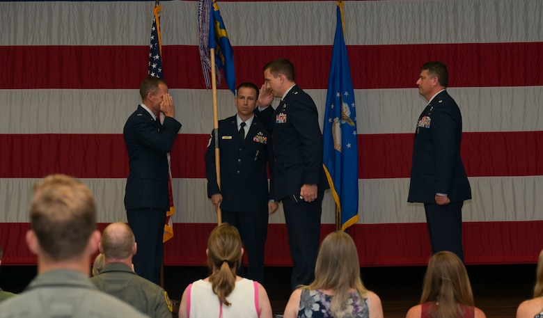 U.S. Air Force Col. Justin Spears, 14th Operations Group commander, Lt. Col. Courtland Stanley, incoming 14th Student Squadron commander, and Lt. Col. Joseph McCane, outgoing 14th STUS commander, pass the guidon,  during a the 14th STUS Change of Command ceremony, June 21, 2021, on Columbus Air Force Base, Miss. The 14th Student Squadron ranks as the largest squadron at Columbus AFB, consisting of 21 active duty and 82 civilian permanent party personnel as well as approximately 700 student pilots from 25 different nations. (U.S. Air Force photo by Airman 1st Class Jessica Haynie)