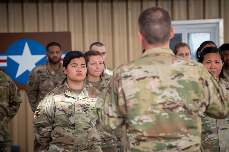 U.S. Air Force Brig. Gen. Andrew Clark, 380th Air Expeditionary Wing commander, administers an oath to the Teal Team 6 (TT6) volunteer members during the Sexual Assault Prevention and Response (SAPR), TT6 induction ceremony at Al Dhafra Air Base (ADAB) United Arab Emirates, June 18, 2021. TT6 members, take an oath to uphold a code of ethics, promote mutual respect, to support others and promise to improve the culture around them.